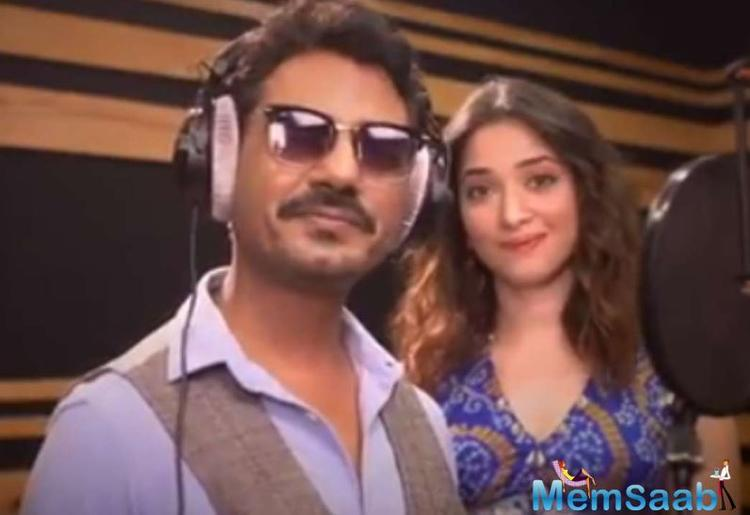 Shared by paparazzi Viral Bhayani on his Instagram handle, Swaggy Chudiyan BTS video has Nawaz and Tamannah inside a recording studio.