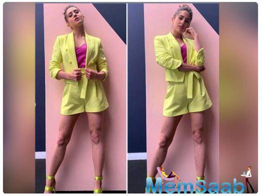 Recently, she was seen wearing a flamboyant outfit. In subtle makeup with pink and brown contours, the actress donned a neon yellow blazer paired with matching shorts and a satin magenta camisole.