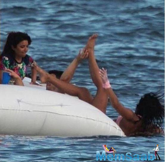 Well, while they were cooling off in the small pool, Nick, being a little playful, dropped Priyanka in the water.