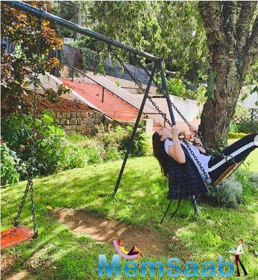 In another photo that the Gully Boy actress shared, she can be seen channelling her inner child on a swing in a garden. She posted the photo with the caption,