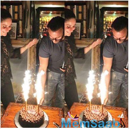 The picture shows Saif cutting a cake as Kareena looks on with a glowing face. Wearing casual t-shirt and denim, Saif is looking dapper in the photo. On the other hand, Bebo is looking gorgeous in a black ensemble.