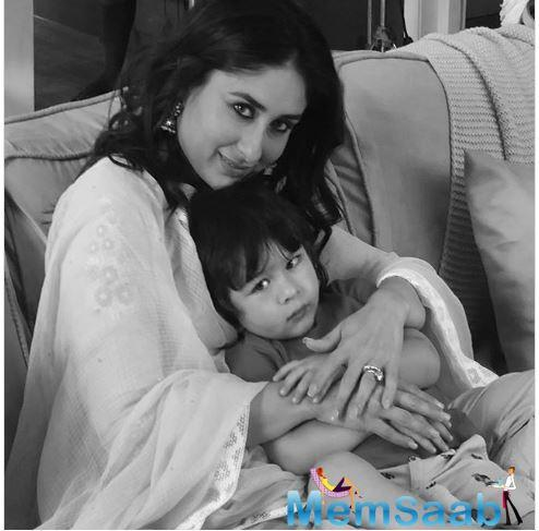 Kareena Kapoor Khan is seen wearing ethnic wear, and Taimur found solace in her arms.