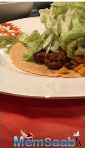 The second post is a boomerang of the lavish spread on the table. The third image has a tortilla with gravy over it and garnished with lettuce leaves. The delicacies looked mouth-watering!