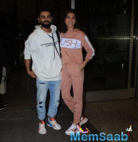 Virat and Anushka, or Virushka as they are called by the fans, were snapped at the airport today and they couldn't seem to stop smiling as they posed together.