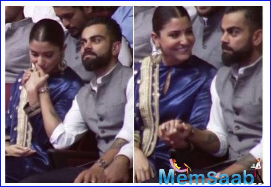 During an event here to rename Feroz Shah Kotla stadium as Arun Jaitley stadium, Anushka was seen kissing the hand of her hubby.