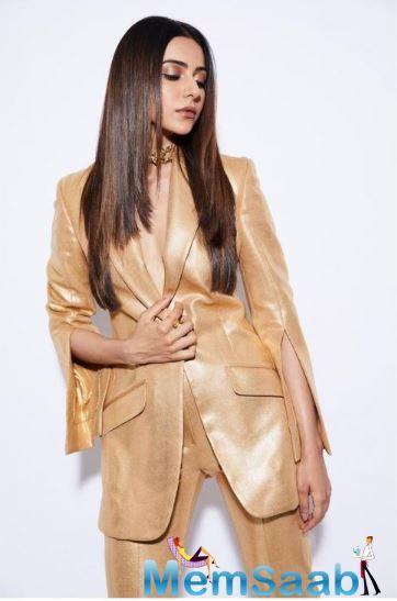 Rakul Preet Singh recently made an eye-grabbing appearance at an award show in a golden pantsuit.
