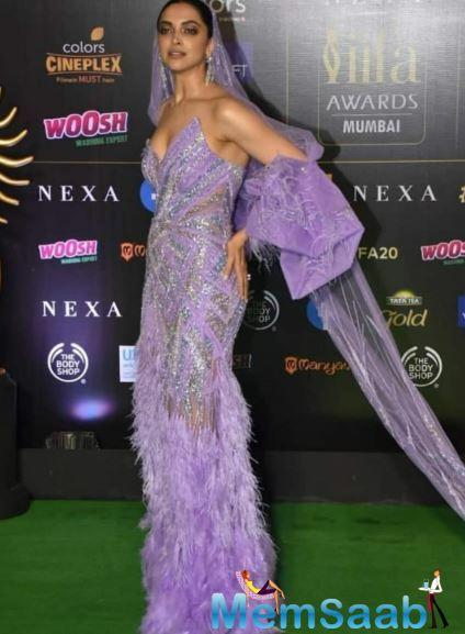 Deepika Padukone stunned in a purple feather detail gown at the 2019 IIFA awards.