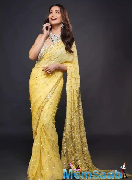Madhuri Dixit's love for saris is quite evident if you scroll through her social media handle. The actress has a never-ending love affair with the nine-yard drape.