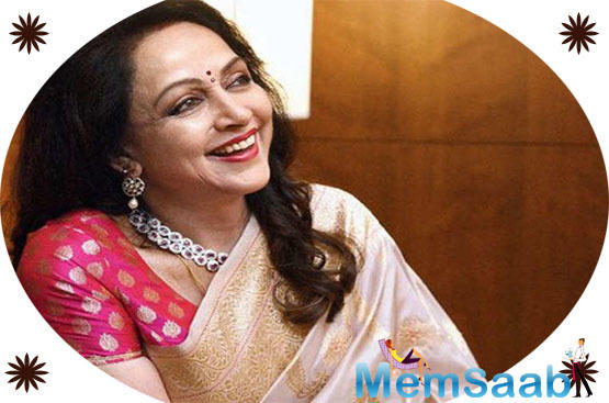 """""""I just had my family with me. My two daughter, my sons-in-law, my grandchildren, and Dharam ji… that's all I need, that's all I want,"""" says the actress as she boards a flight to Delhi, from where she will proceed to Mathura."""