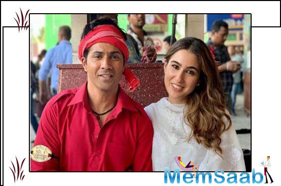 Sara Ali Khan recently shared a cute photo of herself with Varun Dhawan in his coolie garb, sitting in a train station. She wrote,