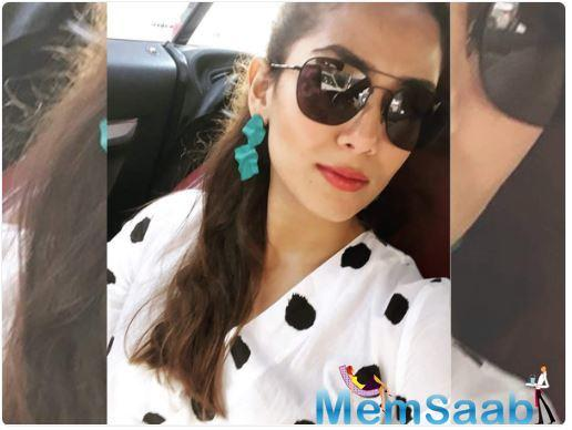She recently shares a selfie where she is seen looking all stunning in her polka dot attire.