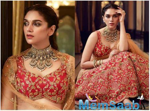 She paired the lehenga with a net dupatta with hand embroidery on it.
