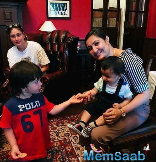 In other photos, Taimur is seen meeting a new little friend. Dressed in a red and blue tee and denim shorts, Taimur looks cute as a button.