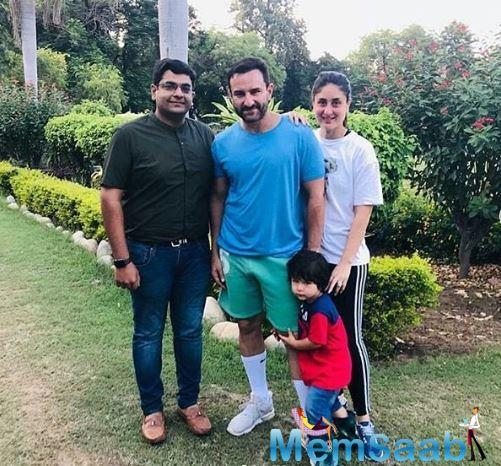 In this pic, little Taimur is seen clinging onto the leg of papa Saif and it is simply adorable!