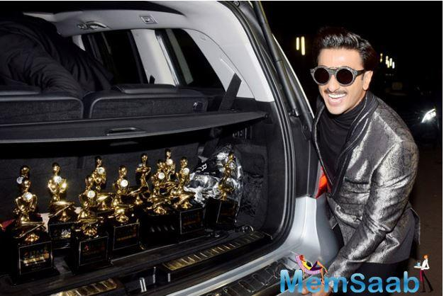 An elated Ranveer was seen proudly displaying his trophies in the trunk of the car