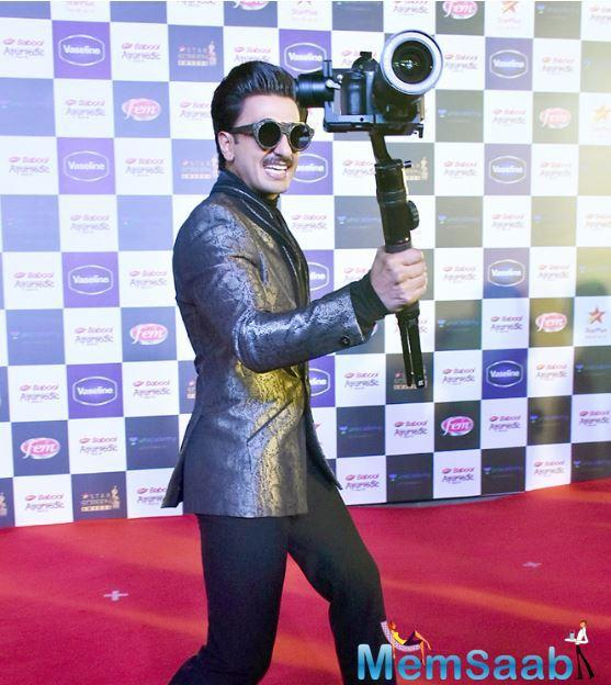 At the red carpet, he was all himself, walking with a camera in hand. Wonder, whose camera was this?