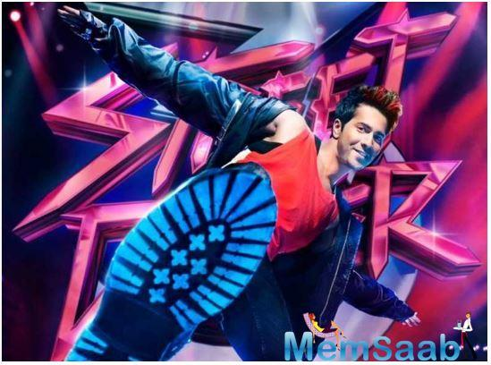 Varun can be seen in jovial mood and he is wearing a red 'ganji' teaming it up with black jacket and black jeans.