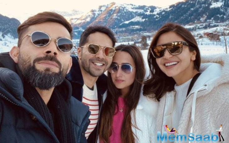 Varun, after bumping into Kareena and Karisma, who are also in the town to bring in their New Year, ran into Anushka-Virat on the Swiss Alps. This time, Natasha was also clicked with the trio, making it a perfect couple picture.