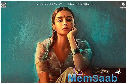 The first poster has Alia Bhatt dressed in a traditional attire sitting against the wall with her hair in two pleats with a gun on the table next to her.
