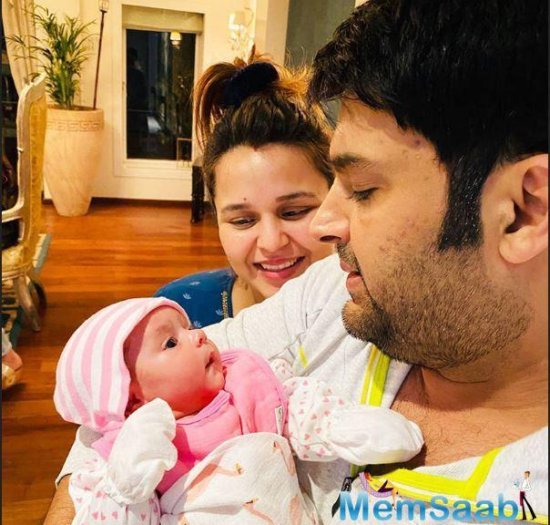 Look here, how the little munchkin looking at her father Kapil Sharma, it is so adorable.