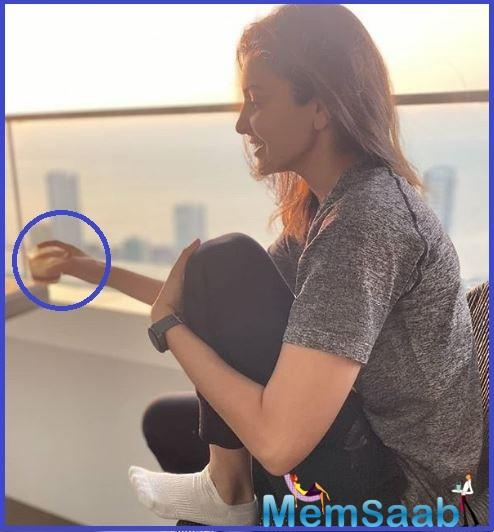 The actor took to Instagram to share two pictures in which she is seen sitting in her balcony and enjoying a cup of hot brew while the Mumbai skyline set the perfect background for the picture.