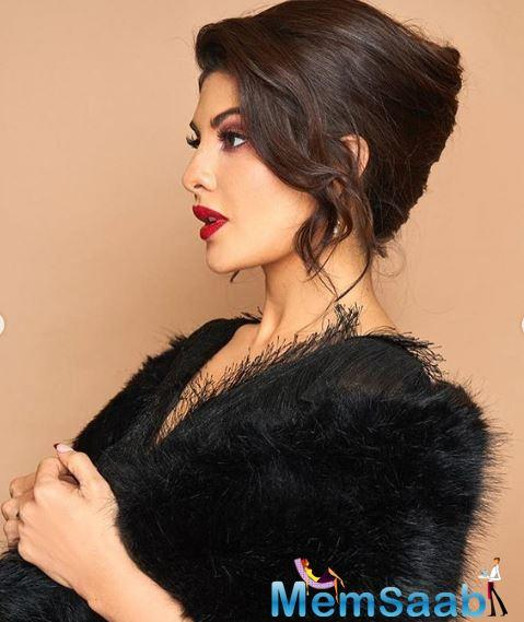 Jacqueline Fernandez was spotted wearing a full-sleeved netted ruffled dress and an open crisscrossed back and layered it up with an extremely soft black fur shrug.