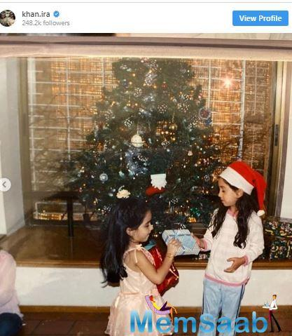 In the picture, a cute little Ira can be seen celebrating Christmas with her father Aamir Khan.