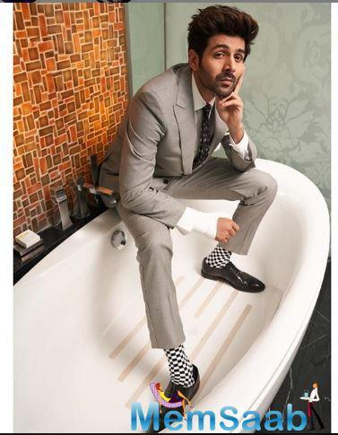 The actor in his Instagram picture is seen dressed in formals from head to toe and sitting in a bathtub.