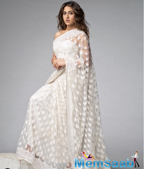 Recently she has posted a picture, where she is seen looking drop-dead gorgeous in a white sheer saree. Dressed in the all-white traditional attire, she is seen striking a stylish pose for the camera.