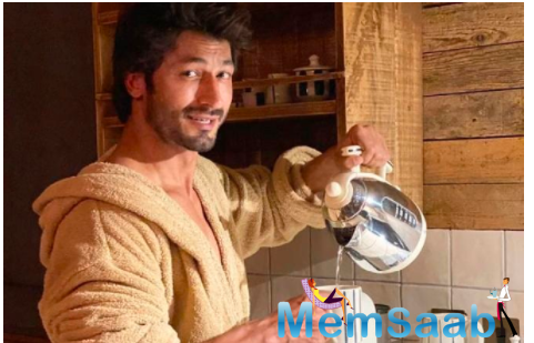 Vidyut shared an Instagram picture where he wears a robe and pours hot water in a cup.