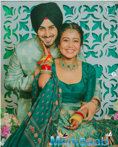 In the pictures shared by Neha on her Instagram handle, we can see the couple enjoying the Mehendi rituals to the fullest.