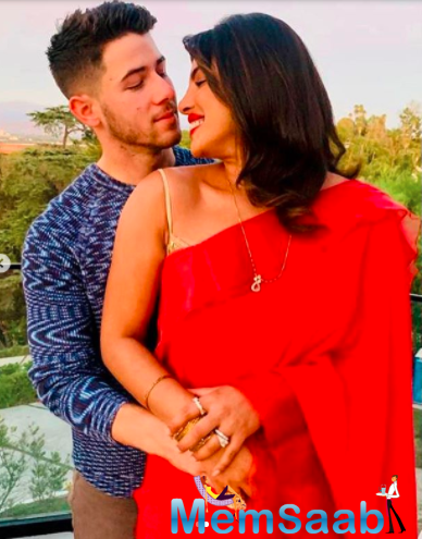 PeeCee shared a cute picture with Nick Jonas, who wore a blue sweater with tan pants. The couple, who tied the knot in 2018, has been inseparable since their wedding.