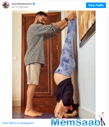 Anushka has shared a photograph on her verified Instagram account where she can be seen performing the Shirshasana with hubby Virat's help.