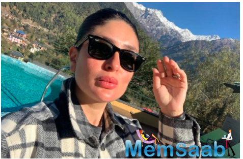 Kareena is seen with her signature bun hair-do with a checkered jacket and black shades.
