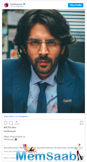 Dressed in what looks like a blood-stained suit, Kartik is seen sporting long hair and a spectacled look in the picture.