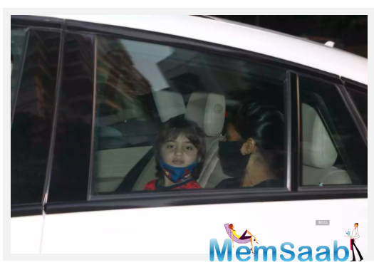 Shah Rukh Khan's wife Gauri Khan and their youngest son AbRam Khan arrived at Karan Johar's residence on Wednesday night.