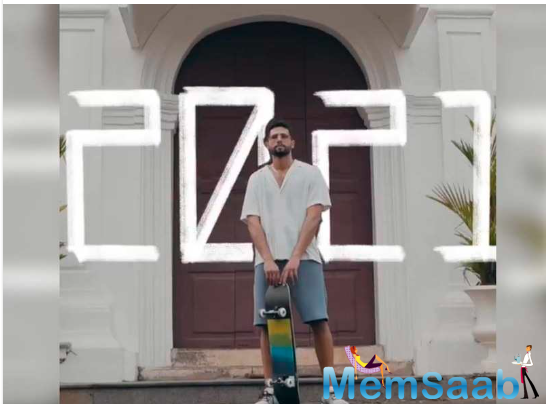 In the Instagram video, he is seen holding a roller skate board with '2021' written in the background.