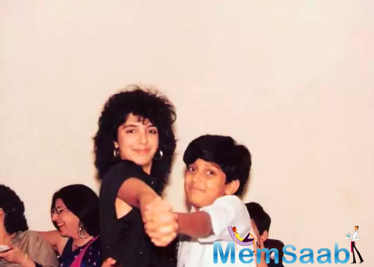 In an Instagram photo she posted, Farah and Farhan strike a dancing pose. Farah is seen wearing a black sleeveless top and curly hair, and Farhan is in his teens and is wearing a white shirt.