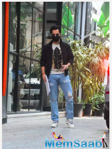 The 'Kalank' actor was snapped outside a production house on Wednesday morning in stylish casuals as he donned a printed white tee and distressed denim which he teamed up with a uber-cool black jacket.