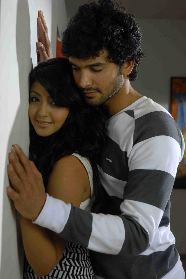 Aindrita Ray hot with Diganth in Parijatha movie