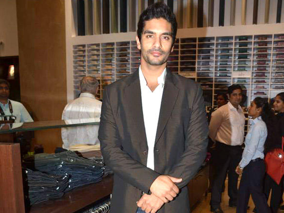 Angad Bedi at Raymonds' new store