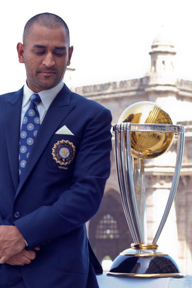 Dhoni With the World Cup 2011 Trophy