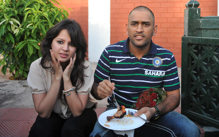 Dhoni and His Wife Sakshi Still