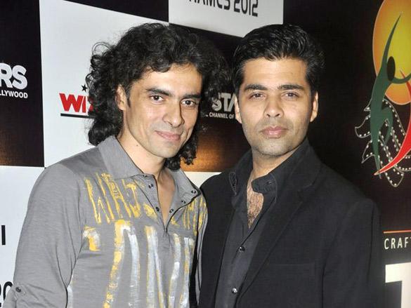 Karan Johar,Imtiaz Ali Poses at  FICCI Frames 2012 Awards