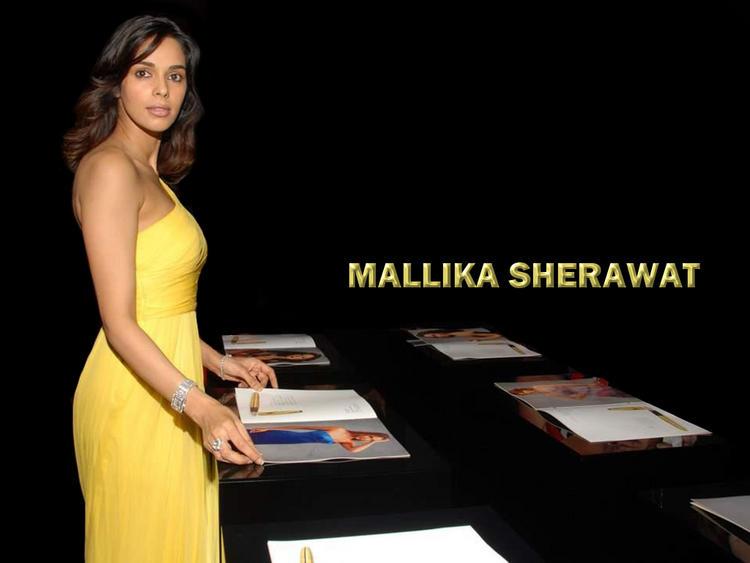 Mallika Sherawat Yellow Dress Wallpaper