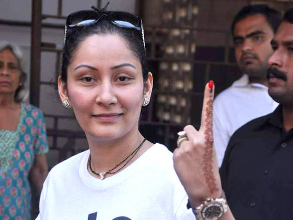 Manyata Dutt flashes her fingers after casting her vote