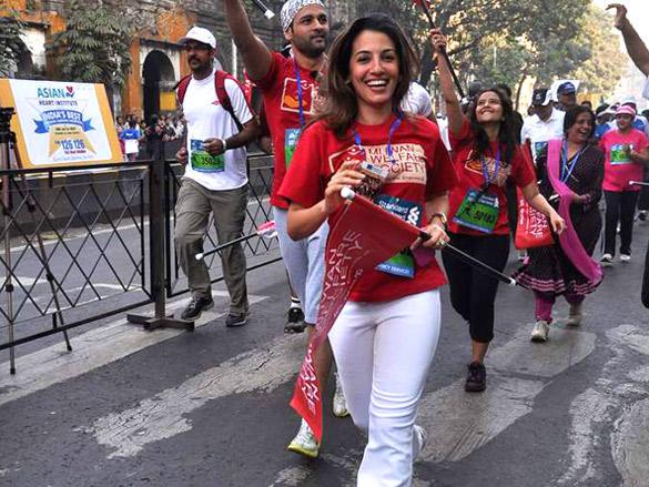 Perizaad Zorabian and Rohit Roy run during Mumbai Marathon