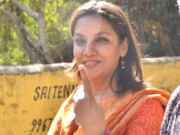 Shabana Azmi flashes her fingers after casting her vote