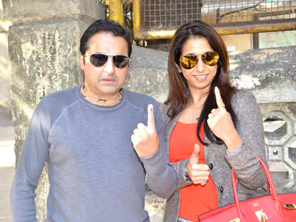 The couple flashes their fingers after casting their vote