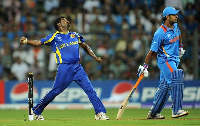 World Cup 2011 Final India VS Sri Lanka Muttiah Muralitharan Boweling and Dhoni Still